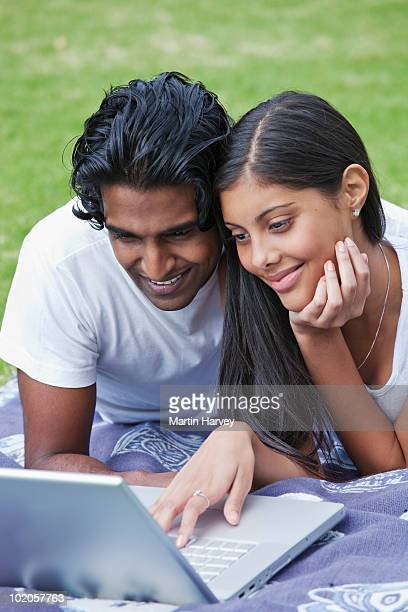 Young Indian couple in the park.