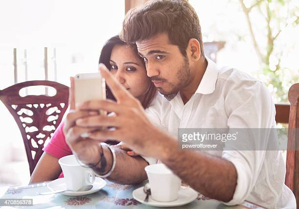 Young Indian Couple Taking a Selfie