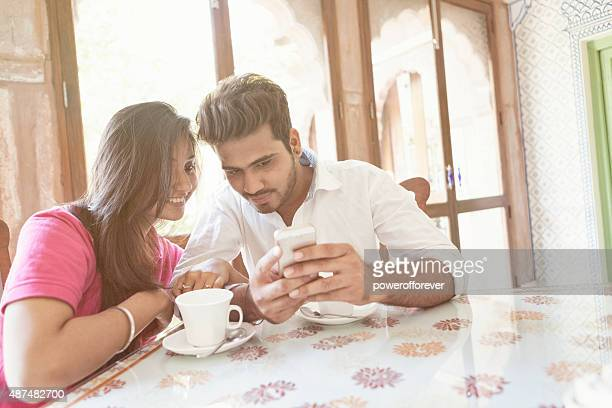 Young Indian Couple using a Smart Phone