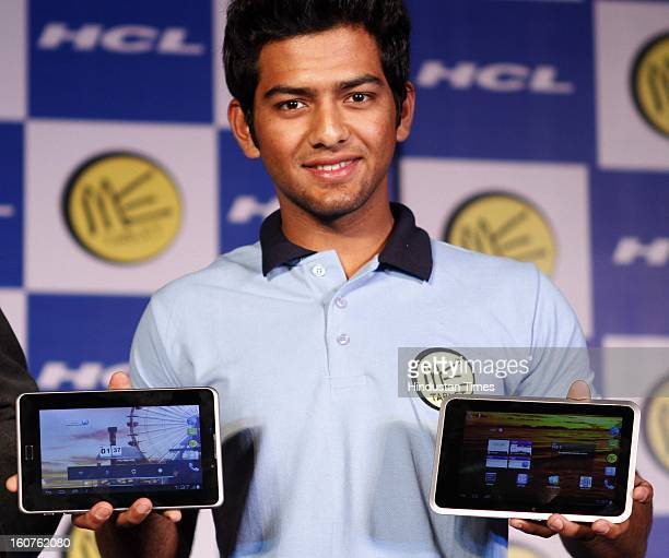 Young Indian cricketer and HCL's new Brand ambassador Unmukt Chand with latest range of HCL ME tabs on February 5 2013 in New Delhi India