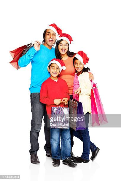 Young Indian family with Christmas shopping