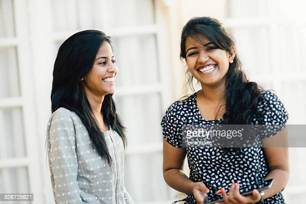 Young Indian Female Friends Using Digital Tablet