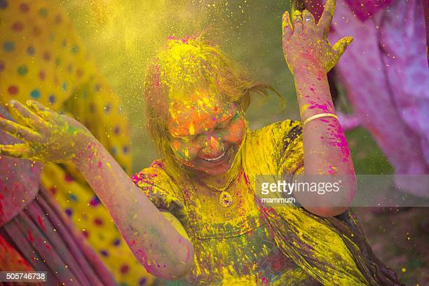 Young indian girl celebrating holi festival in India
