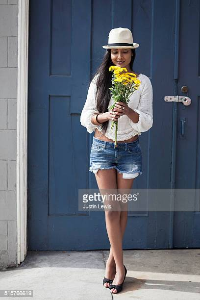 Young indian girl with flowers smiling