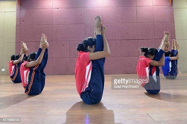 Young Indian girls from the Yoga and Cultural Association of Gujarat practice yoga in Ahmedabad on June 18 2015 Gujarat's girls yoga team is invited...