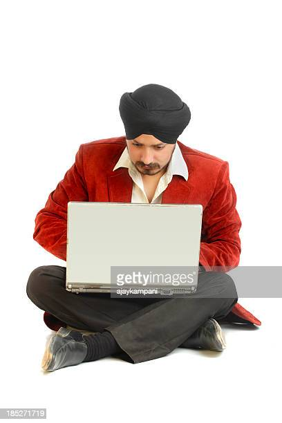 Young Indian man with laptop