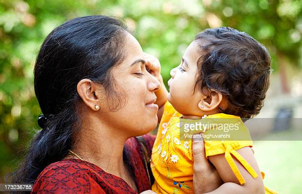 Young Indian Mother Loving Baby Girl Daughter