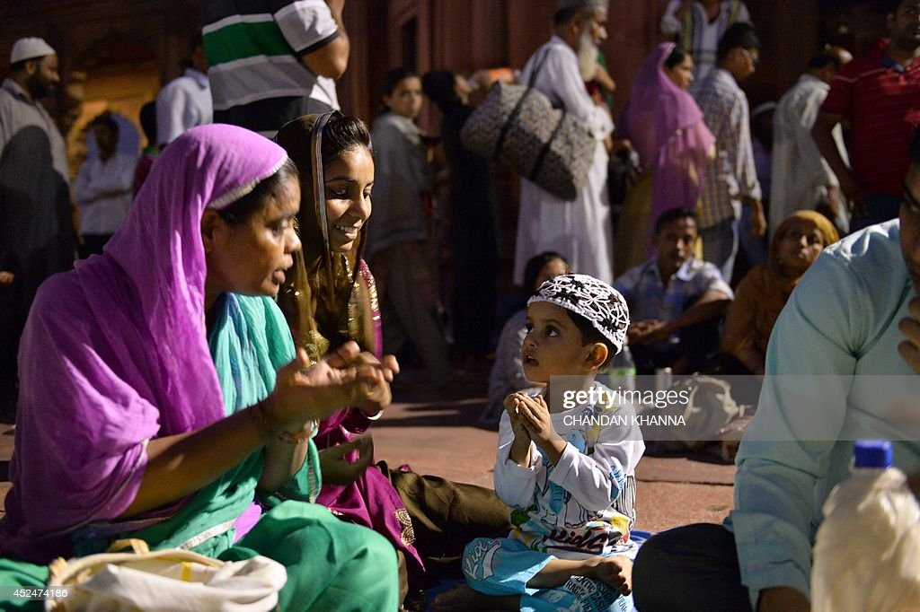 A young Indian muslim boy is taught by relatives to offer namaz during the Islamic holy month of Ramadan in New Delhi on July 20, 2014. During the holy month of Ramadan Muslims around the world focus on prayer, fasting, giving to charity, and religious devotion.