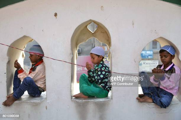 Young Indian Muslims take part in Eid alFitr prayers at the Khairuddin Mosque in Amritsar on June 26 2017 Muslims around the world are celebrating...