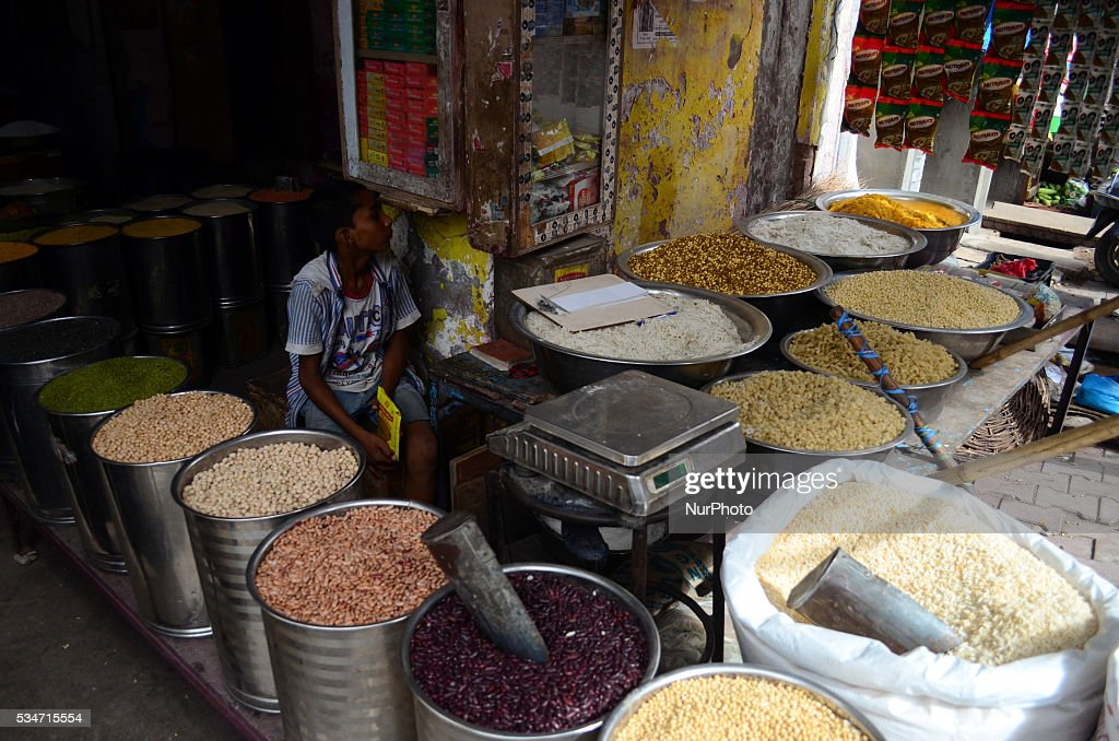 A young indian shopkeeper boy sit as he waits for customers in a whole sale grocery shop, in old market of Allahabad on May 27,2016.A United nation's latest report has estimated that India could lose $49 billion (more than 3 lakh crore) of its GDP if global food prices double. India will see the second highest loss after china,which is estimated to lose $161 billion of its GDP because of volatile food prices. The report said the world is likely to suffer from more volatile food commodity prices because of several reasons, including climate change and rising populations.