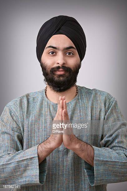 Young Indian sikh with hands folded - namaste