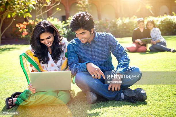 Young Indian Students using laptop on School Grounds