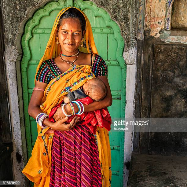 Young Indian woman breastfeeding her newborn baby, Amber, India