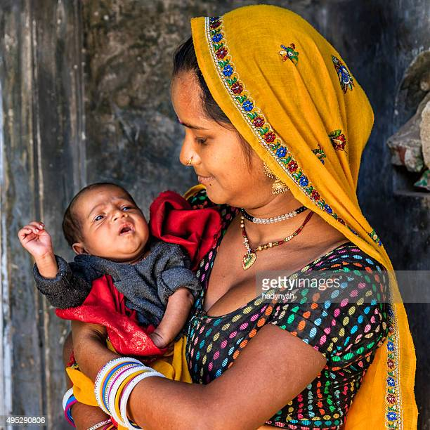 Young Indian woman holding her newborn baby, Amber, India