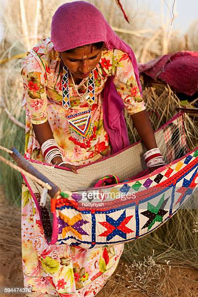 Young Indian woman holding her newborn baby, India