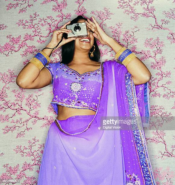Young Indian Woman in Traditional Clothing Taking a Picture