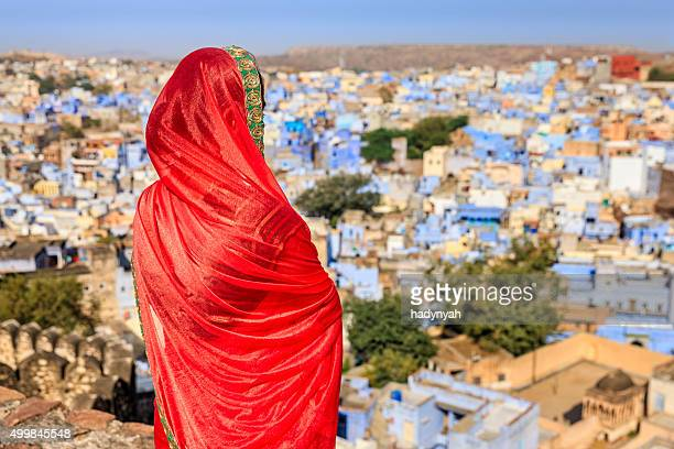 Young Indian woman looking at the view, Jodhpur, India