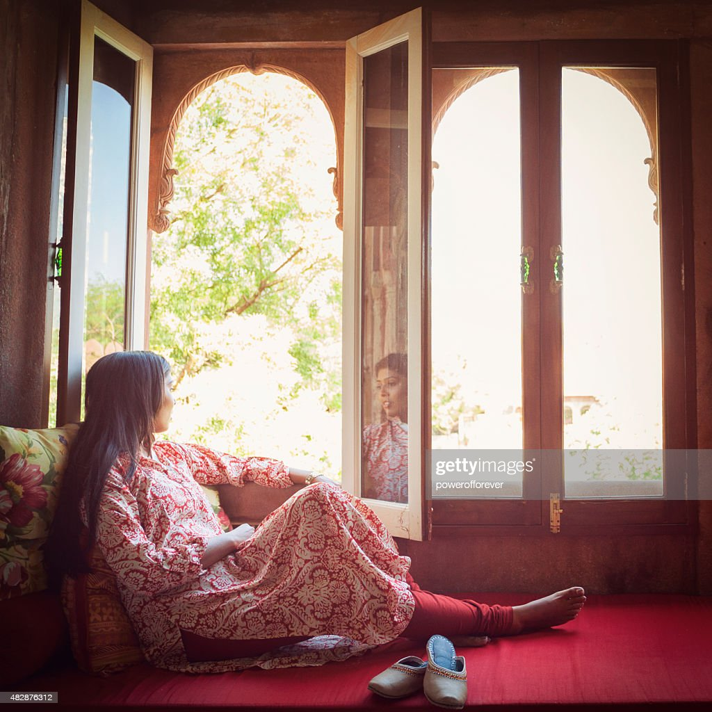 Young Indian Woman Looking out a Window