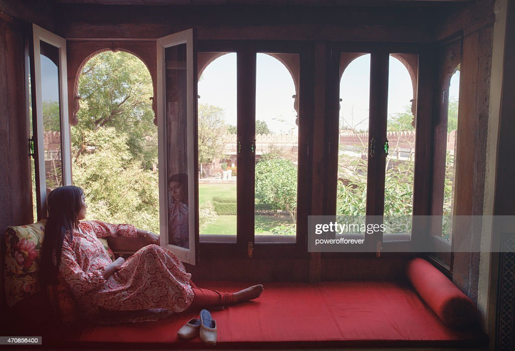 Young Indian Woman Relaxing in a Window Nook