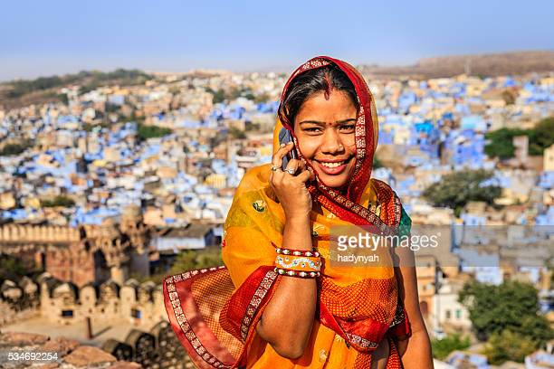 Young Indian woman using mobile phone, Jodhpur, India