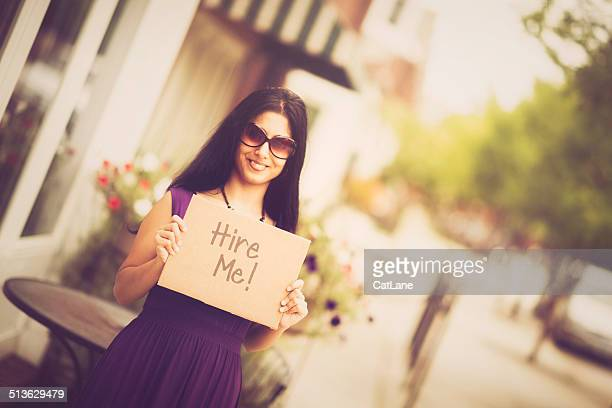 Young Indian Woman with Hire Me Sign