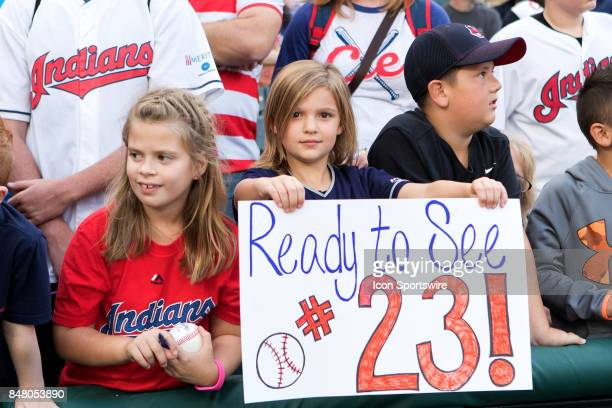 A young Indians fan holds up a sign prior to the Major League Baseball game between the Kansas City Royals and Cleveland Indians on September 15 at...