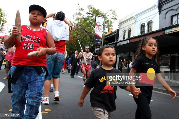 Young indigenous children take part in the ANZAC march towards Redfern Park on April 25 2017 in Sydney Australia The annual ANZAC coloured diggers...