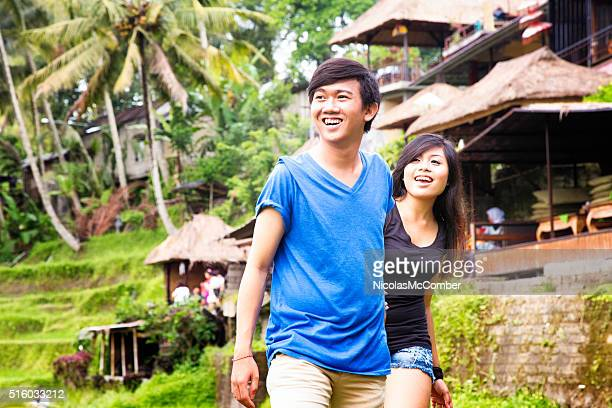 Young Indonesian couple discovering Bali village on hill