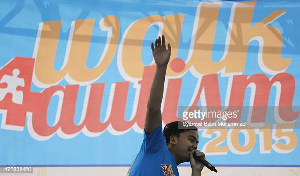 A young Indonesian with autistic disorder performs during Walk for Autism 2015 on May 10 2015 in Jakarta Indonesia Hundreds of autistic children and...