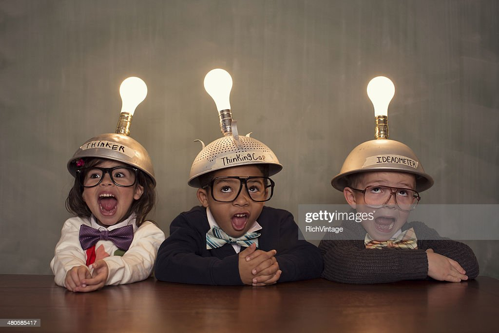 Young Intelligent Children Nerds wearing Thinking Caps : Stock Photo