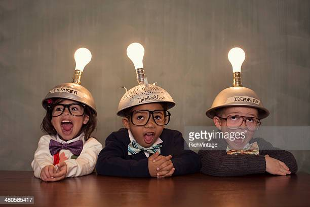 Young Intelligent Children Nerds wearing Thinking Caps