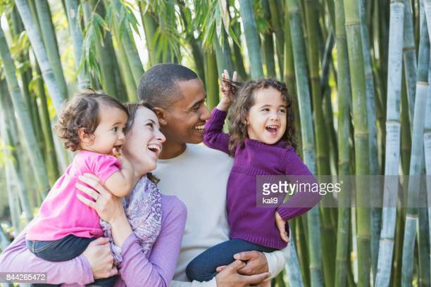 Young interracial family with two little girls