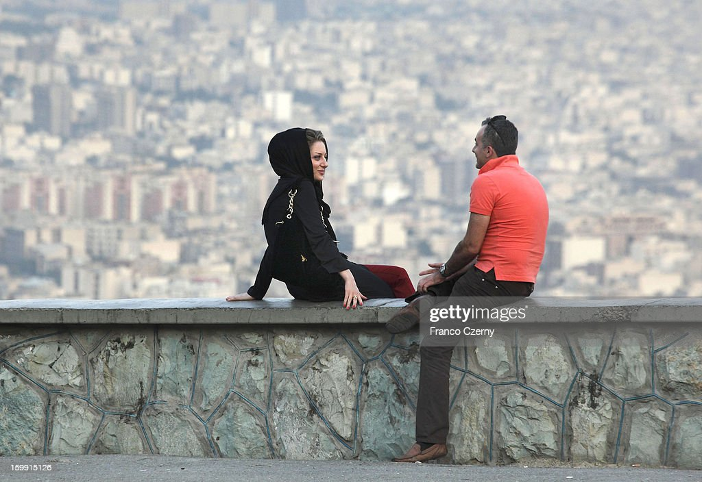 A young iranian couple chat to each otheron August 28 2012 in Tehran Iran