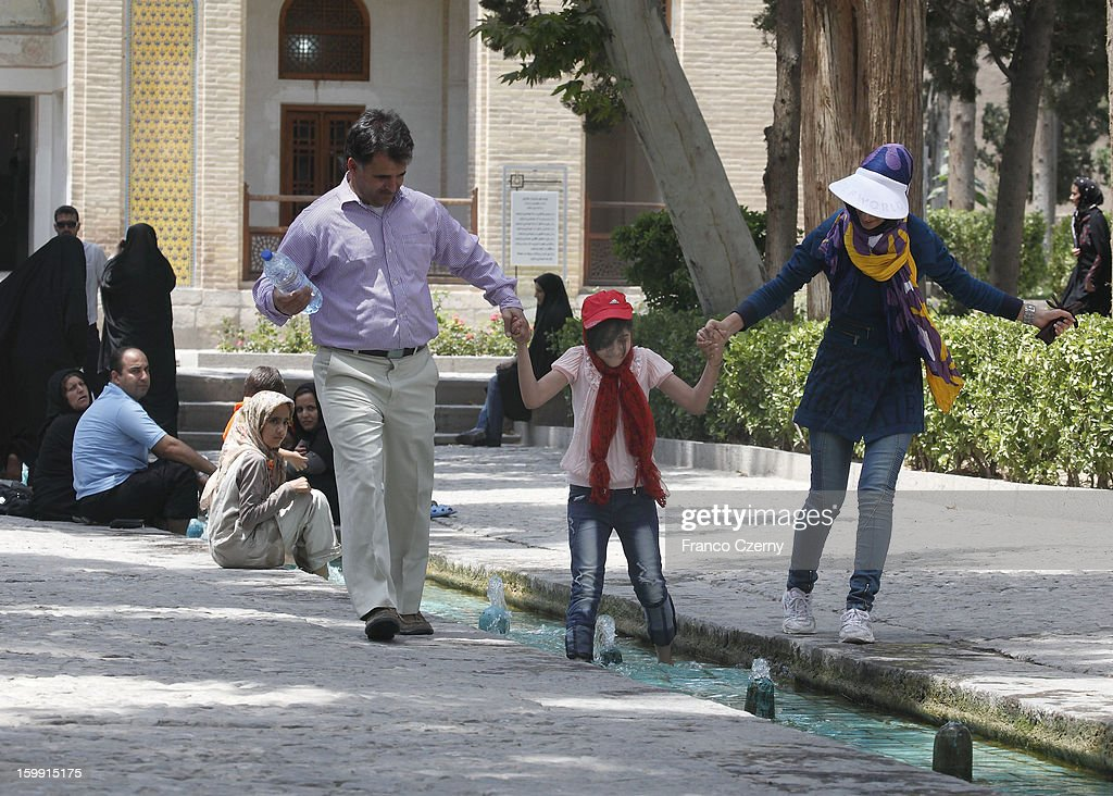 A young iranian family with a daughter cool off at the Fin Garden on August 15, 2012 in Kashan, Iran.
