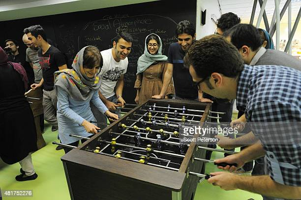 Young Iranian hightech and startup specialists play foosball during their lunch break at Sarava a local venture capital firm that invests in startups...