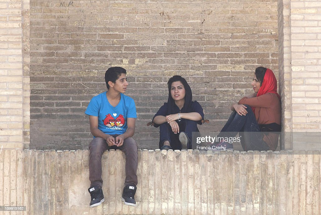 Young Iranian's gather at the si-o-seh bridge, or the Bridge of 33 Arches on August 17, 2012 in Isfahan, Iran.