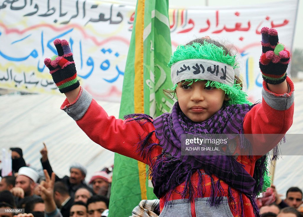A young Iraqi girls flashes victory signs during a protest in the western Iraqi city of Ramadi on January 25, 2013. The longest-running of the protests, in Ramadi, has cut off a key trade route linking Baghdad to Jordan and Syria for a month. AFP PHOTO/AZHAR SHALLAL