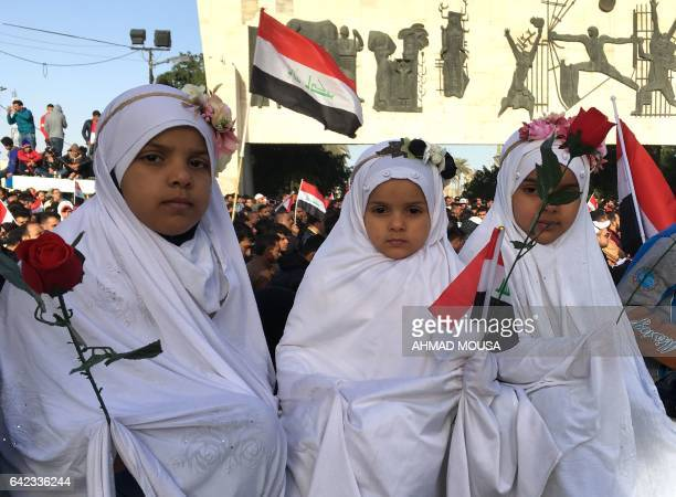 Young Iraqi girls take part in a silent protest of mostly supporters of prominent cleric Moqtada Sadr on February 17 2017 in central Baghdad...
