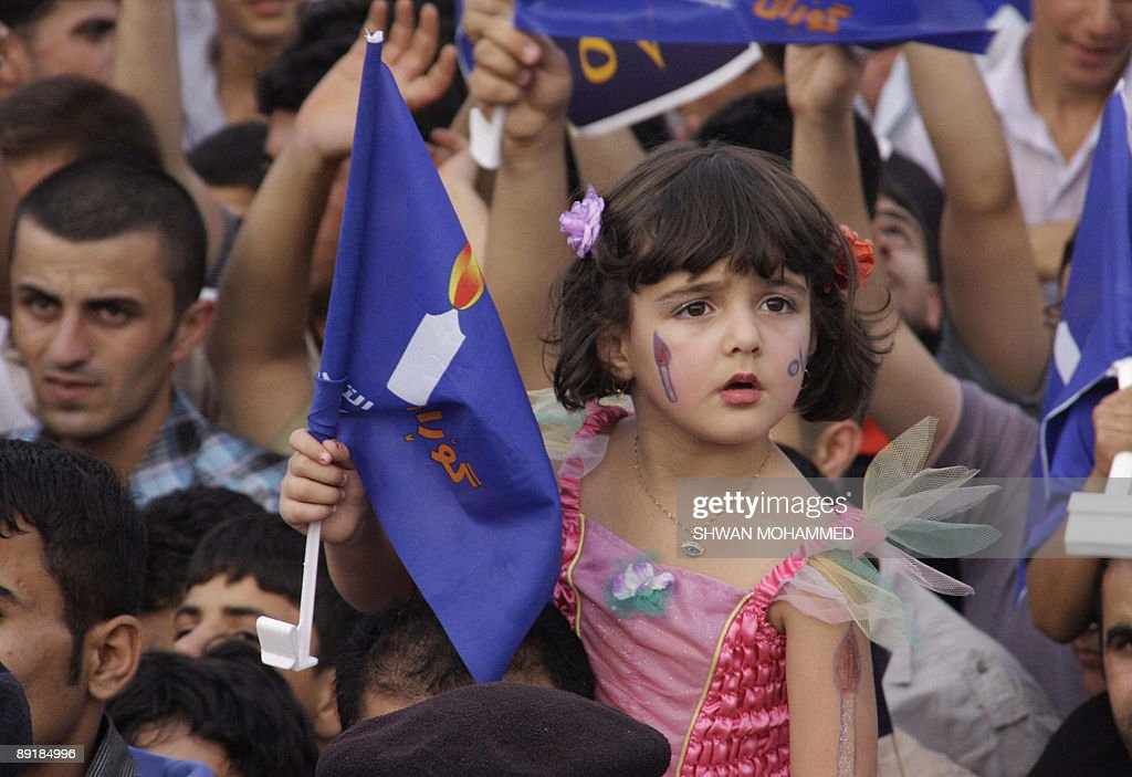 A young Iraqi Kurdish girl with her face painted sits on the shoulder of her father during a rally in support of the 'Change list' led by Nusherwan...