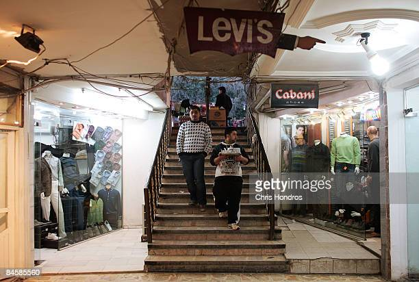 Young Iraqi men descend a staircase into an underground shopping mall in the Karradah neighborhood February 2 2009 in central Baghdad Iraq Baghdad's...