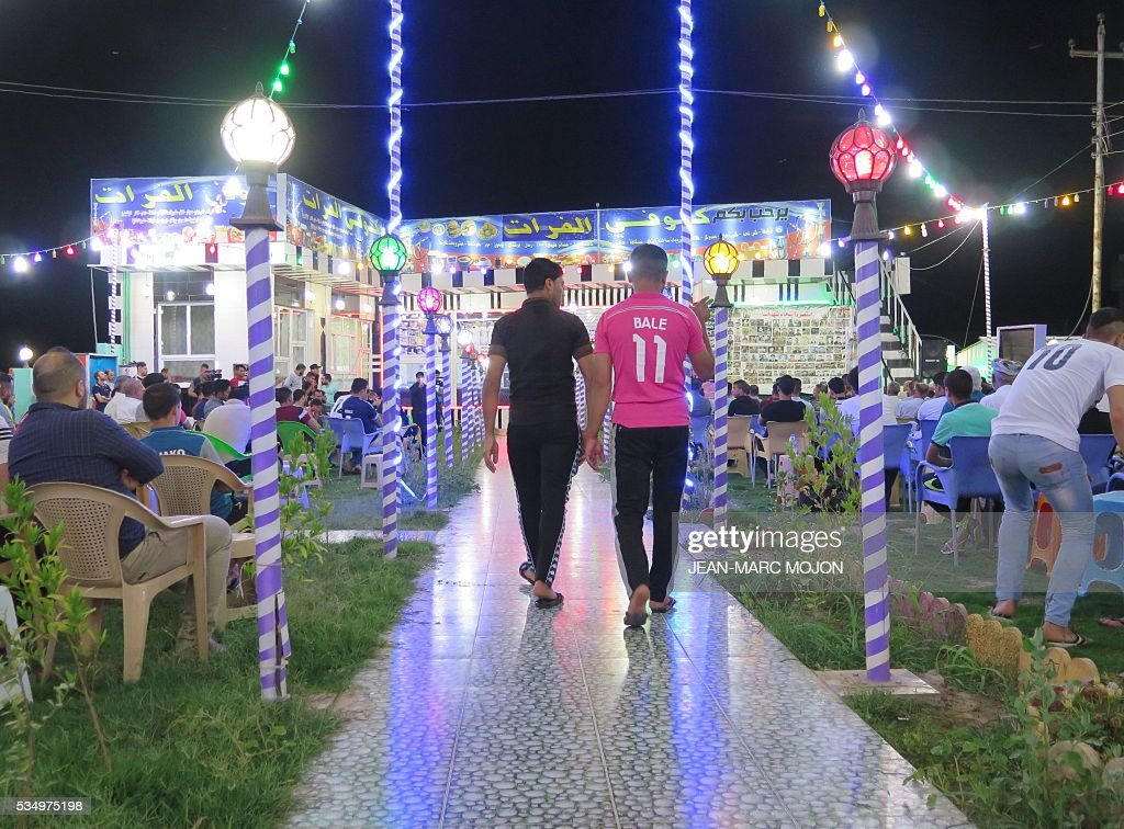 Young Iraqis attend a memorial ceremony at the Al-Furat cafe in Balad, 80 km north of Baghdad, ahead of the Champions League final between Real Madrid and Atletico Madrid. The cafe, which hosts a local Real Madrid fan club, was the scene on May 13 of an attack that left a total of 16 people dead, according to officials. The deadly was claimed by the Islamic State group and sparked an outpouring of sympathy from the football world. / AFP / Jean-Marc Mojon