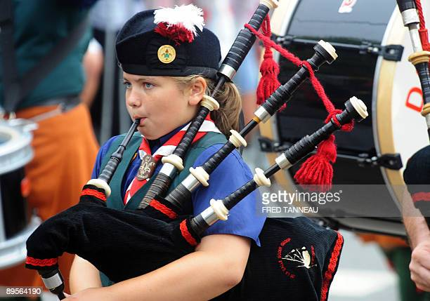 A young Irish musician of the 'De La Salle Scout Pipe Band' parades playing bagpipe on August 2 2009 in Lorient western France during the celtics...