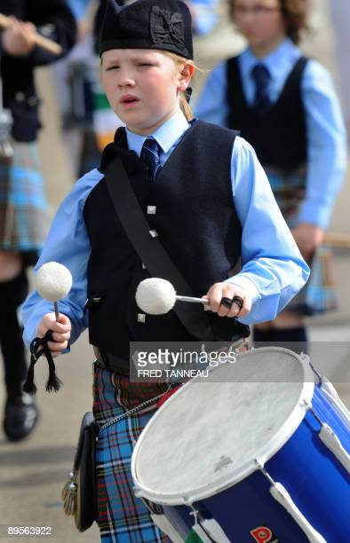 A young Irish musician of the New Ross Pipe Band parades on August 2 2009 in Lorient western France during the celtics nations Great Parade of the...