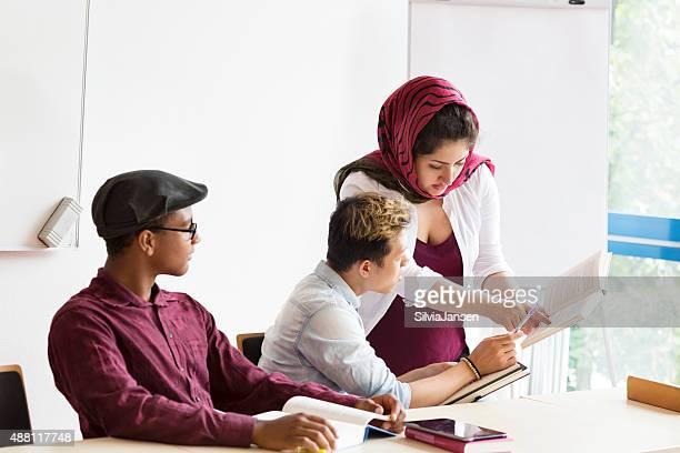 young islam teacher explaining
