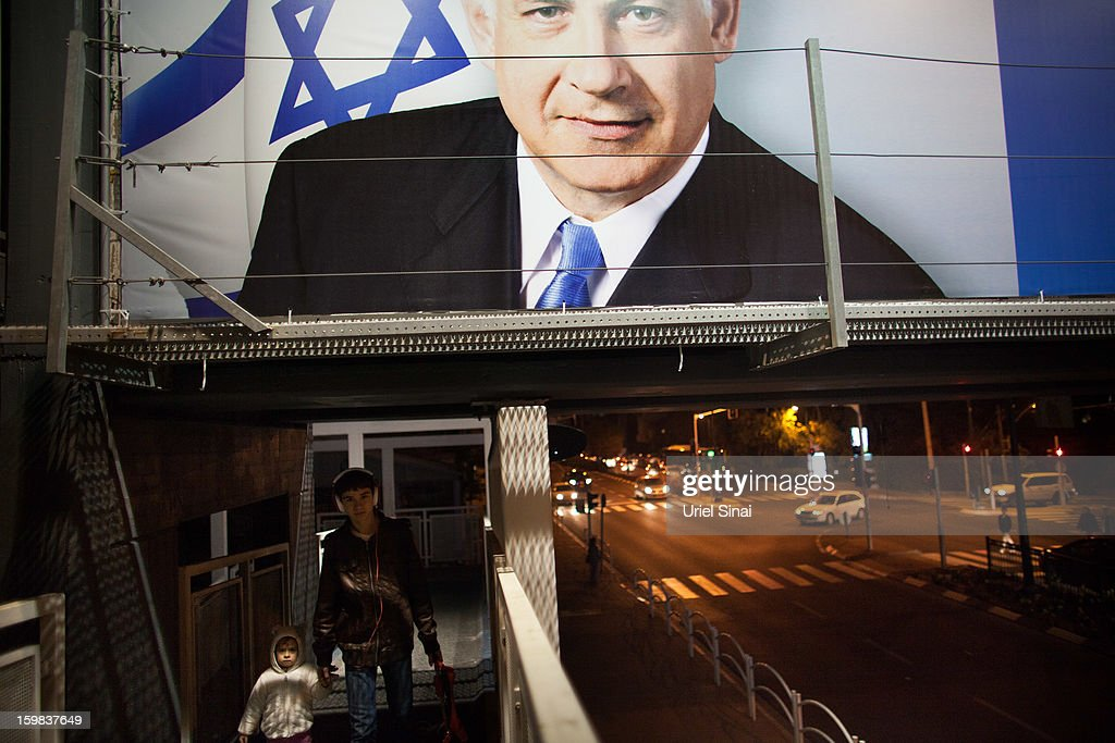Young Israeli boys walk past a poster of Israeli Prime Minister Benjamin Netanyahu ahead of the upcoming Israeli elections on January 21, 2013 in Ramat Gan, Israel. Israeli elections are scheduled for January 22 and so far showing a majority for the Israeli right.