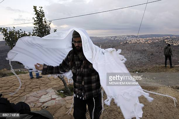 A Young Israeli settler is seen in the settlement outpost of Amona which was established in 1997 and built on private Palestinian land in the...