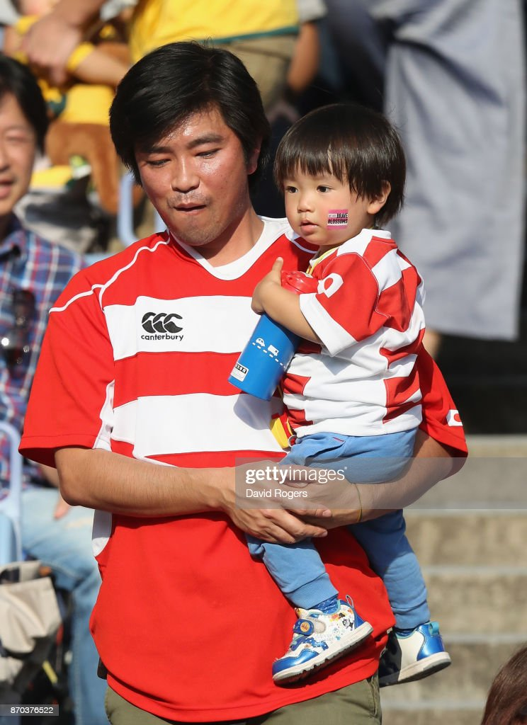 A young Japan fan is carried into the stadium by his father during the rugby union international match between Japan and Australia Wallabies at Nissan Stadium on November 4, 2017 in Yokohama, Kanagawa, Japan.
