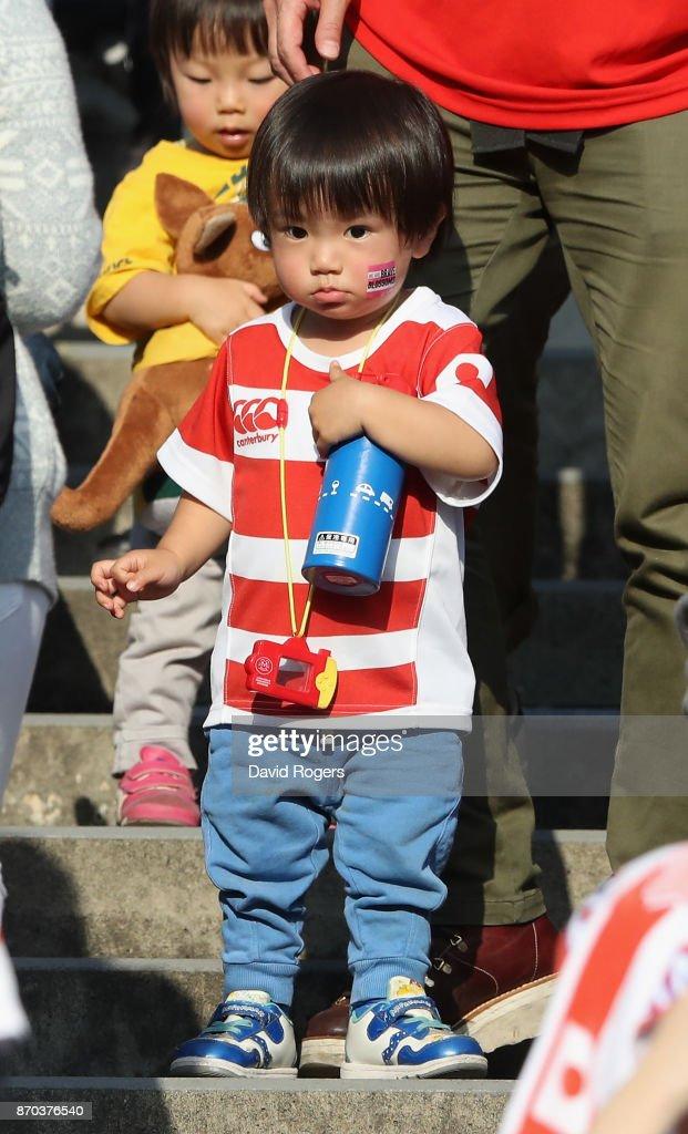 A young Japan fan looks on during the rugby union international match between Japan and Australia Wallabies at Nissan Stadium on November 4, 2017 in Yokohama, Kanagawa, Japan.
