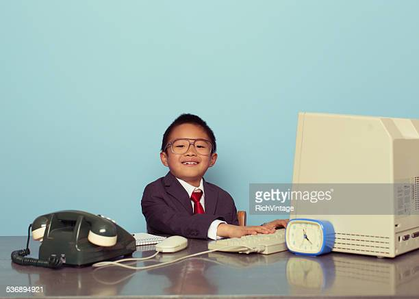 Young Japanese Boy Businessman Smiles in Office