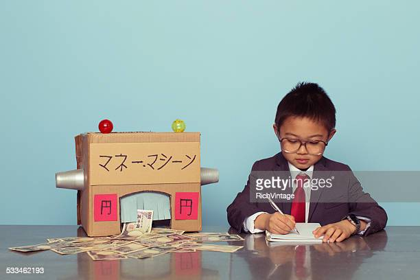 Young Japanese Boy is Making Money
